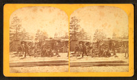 Group_of_men_in_front_of_a_log_cabin