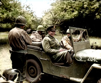 Eisenhower in a jeep in a Normandy Orchard
