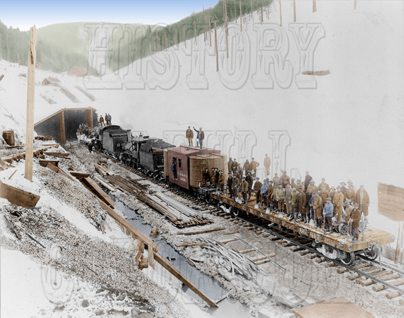 3c16413 - First train going through the C.M. & St. P. Pass